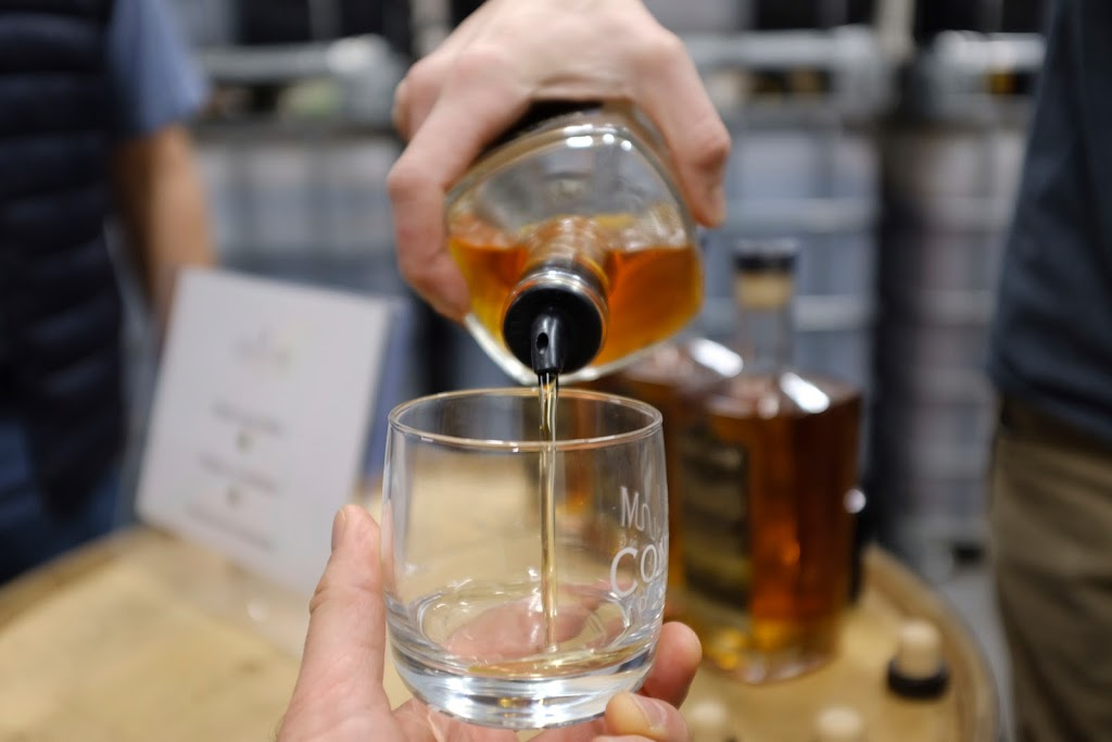 A pour of Charred whiskey by Continuum Distilling | Local Food Rocks